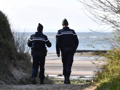 French Gendarmes patrol the beaches at Tardinghen near the northern port city of Calais on April 4, 2019. - Since the end of October 2018, the French and British authorities have been facing an upsurge in illegal Channel crossings from France to Britain by migrants and refugees. A plan by …