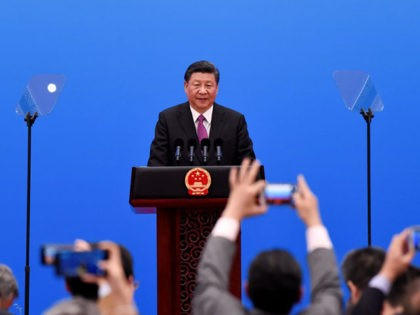 China's President Xi Jinping speaks at a press conference at the end of the final day of the Belt and Road Forum at the China National Convention Centere at the Yanqi Lake venue outside Beijing on April 27, 2019. (Photo by WANG ZHAO / POOL / AFP) (Photo credit should …
