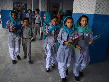 In this photo taken on July 16, 2019, Afghan schoolgirls leave after the mid-term exams at a school in Kabul. - The US and the Taliban say they are making progress in ongoing peace talks, but little has changed for ordinary Afghans, and recent attacks show how children are as …