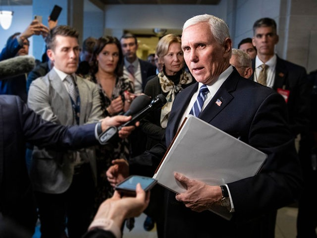 WASHINGTON, DC - MARCH 04: Vice President Mike Pence stops to talk to reporters briefly as he leaves the US Capitol after meeting with Congressional Democrats and Republicans, in separate closed-door meetings, on recent developments with the novel coronavirus, or COVID-19, on March 4, 2020 in Washington, DC. Fears that …