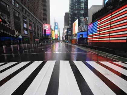 TOPSHOT - A nearly empty Times Square is seen on March 23, 2020 in New York City. - Wall Street fell early March 23, 2020 as Congress wrangled over a massive stimulus package while the Federal Reserve unveiled new emergency programs to boost the economy including with unlimited bond buying. …
