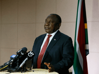 South African President Cyril Ramaphosa conduct a press conference moments after concluding a virtual extraordinary G20 Leaders' Summit on a coordinated international response to the current COVID-19 pandemic at the South African Reserve Bank, in Pretoria on March 26, 2020. - South African President Cyril Ramaphosa on March 23, 2020 …