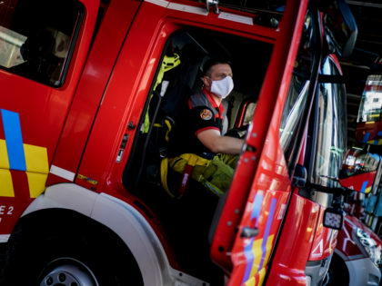 Belgian firemen prepare their vehicles at the Central Fire Station in Liege on April 10, 2020, were members are helping in the evacuation of patients suspected of having contracted COVID-19, the disease caused by the novel coronavirus. - Fire fighters have been helping the ambulance services, hospitals and medics as …