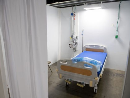 A patient room is seen at a temporary field hospital featuring 437 beds for patients suffering from coronavirus, COVID-19, and part of the city's medical surge response plan as an alternate care site to assist hospitals at the Walter E. Convention Center in Washington, DC, May 11, 2020. (Photo by …