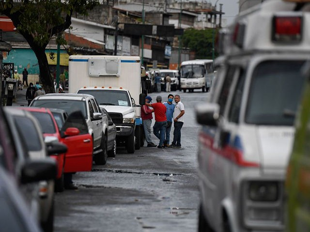 Drivers queue to refuel the tanks of their cars at a gas station, in Caracas on June 1, 2020 amid the novel COVID-19 coronavirus outbreak. - Venezuela will increase fuel prices in June, President Nicolas Maduro said on Saturday, putting a limit on state subsidies that for decades had allowed …