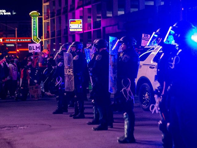 "Police officers stand guard, on June 1, 2020, in downtown Las Vegas, during a ""Black lives matter"" rally in response to the recent death of George Floyd, an unarmed black man who died while in police custody. - Thousands of National Guard troops patrolled major US cities after five consecutive …"