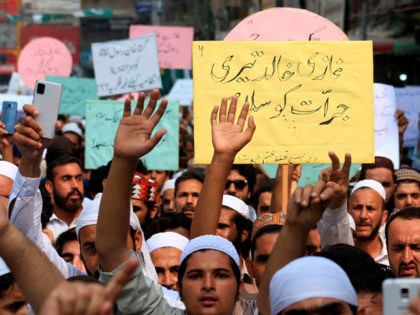 Supporters of a religious group Aalmi Majlis Tahaffuz Khatm-e-Nubuwwat, march during a rally in support of Khalid Khan, who killed a man allegedly accused of blasphemy, in Peshawar on July 31, 2020. - A Pakistani man facing charges of blasphemy was shot dead in court on July 29 as he …
