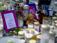 A makeshit memorial with candles, flowers, a teddy bear and a note is seen at the site where a twelve year old girl was shot near a petrol station in Botkyrka, south of Stockholm, on August 3, 2020. - The young girl suffered gunshot injuries on the early morning of …