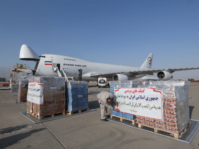 Iranian Red Crescent workers load a plane with aid to the Lebanese people on the tarmac of Mehrabad airport in the capital Tehran, on August 5, 2020. - The death toll from a huge blast at Lebanon's Beirut port has risen to at least 113, as at least 4,000 people …