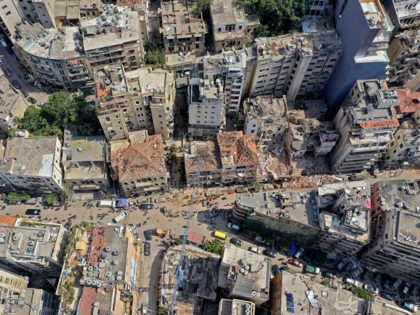 An aerial view shows damaged buildings in Beirut on August 7, 2020, three days after a colossal explosion of a huge pile of ammonium nitrate that had languished for years in a port warehouse, left scores of people dead or injured and caused devastation in the Lebanese capital. (Photo by …