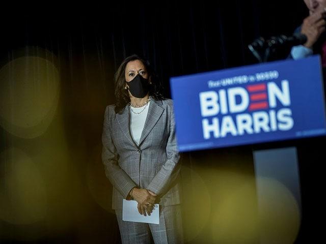 WILMINGTON, DE - AUGUST 13: Presumptive Democratic vice presidential nominee, U.S. Sen. Kamala Harris listens as presumptive Democratic presidential nominee former Vice President Joe Biden speaks following a coronavirus briefing with health experts at the Hotel DuPont on August 13, 2020 in Wilmington, Delaware. Harris is the first Black woman …
