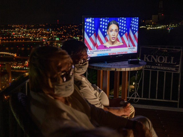 PITTSBURGH, PA - AUGUST 18: Guests watch television coverage of the Democratic National Convention at a virtual DNC party overlooking the city on August 18, 2020 in Pittsburgh, Pennsylvania. The convention, which was once expected to draw 50,000 people to Milwaukee, Wisconsin, is now taking place virtually due to the …