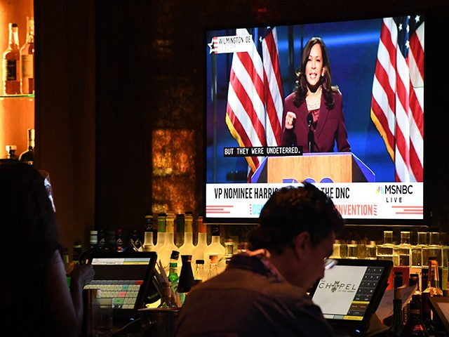 Senator from California and Democratic vice presidential nominee Kamala Harris is seen on television screens as she speaks during the third day of the Democratic National Convention, being held virtually amid the novel coronavirus pandemic, at The Abbey bar and restaurant in West Hollywood, California, August 19, 2020. (Photo by …