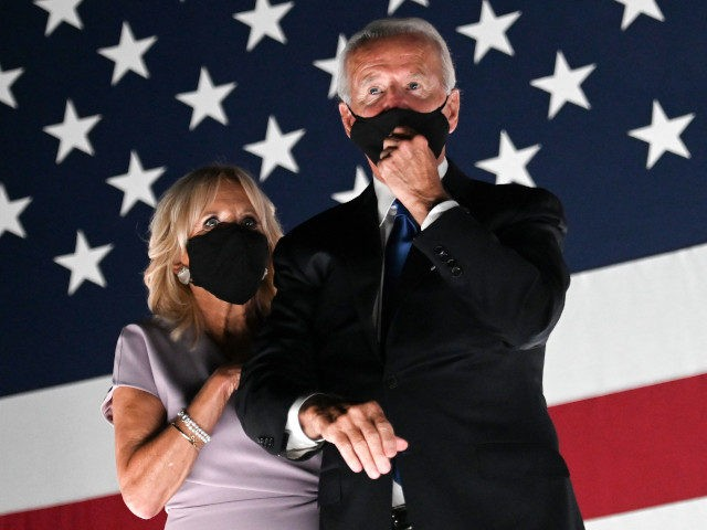 Jill Biden and husband former vice-president and Democratic presidential nominee Joe Biden wear facemasks as they watch fireworks outside the Chase Center in Wilmington, Delaware, at the conclusion of the Democratic National Convention, held virtually amid the novel coronavirus pandemic, on August 20, 2020. (Photo by Olivier DOULIERY / AFP) …
