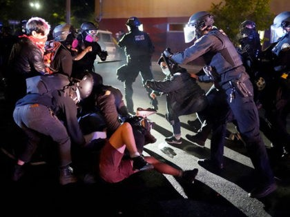 PORTLAND, OR - AUGUST 22: Protesters and Portland police clash while dispersing a crowd gathered in front of the Portland Police Bureau North Precinct early in the morning on August 22, 2020 in Portland, Oregon. Friday marked the 86th night of protests in Portland following the death of George Floyd. …