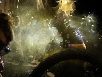 Pepper spray is deployed to disperse a group of protestors, organized by Charlotte Uprising, as they clash with Charlotte-Mecklenburg police for a third night in a row during demonstrations near the site of the 2020 Republican National Convention in uptown Charlotte, North Carolina on August 23, 2020. - The group, …