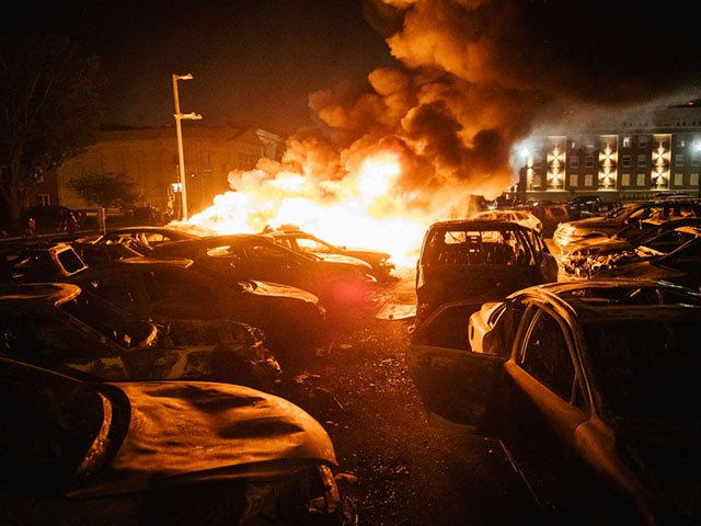 KENOSHA, WI - AUGUST 24: Cars are set on fire in a used car lot on August 24, 2020 in Kenosha, Wisconsin. This is the second night of rioting after the shooting of Jacob Blake, 29, on August 23. Blake was shot multiple times in the back by Wisconsin police officers after attempting to enter into the drivers side of a vehicle. (Photo by Brandon Bell/Getty Images)