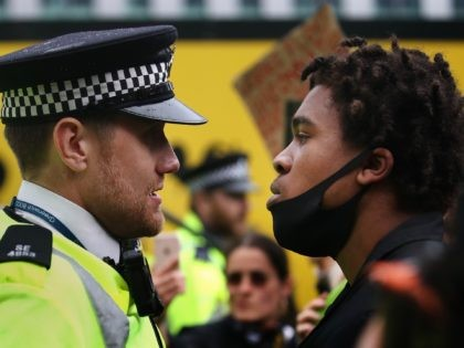 LONDON, UNITED KINGDOM - JUNE 06: A protester confronts a Police Officer during a Black Lives Matter protest on June 06, 2020 in London, United Kingdom. The death of an African-American man, George Floyd, while in the custody of Minneapolis police has sparked protests across the United States, as well …