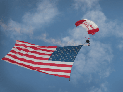 Double-Amputee Veteran Skydives with American Flag, Trump 2020 Parachute