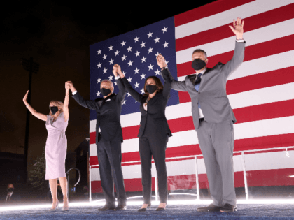 Democratic presidential nominee Joe Biden, his wife Dr. Jill Biden, Democratic Vice Presidential nominee Kamala Harris and her husband Douglas Emhoff raise their arms on stage outside the Chase Center after Biden delivered his acceptance speech on the fourth night of the Democratic National Convention from the Chase Center on …