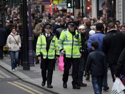 LONDON, ENGLAND - DECEMBER 27: Police patrol Oxford Street on December 27, 2011 in London, England. Police say they are holding 11 people on suspicion of murder after a teenager was stabbed to death on London's busiest shopping street on Boxing Day. (Photo by Peter Macdiarmid/Getty Images)
