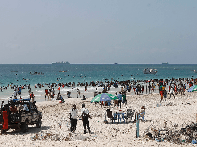 "Police patrol Lido beach on December 7, 2012 on the Indian Ocean's coastal city of Mogadishu. The humanitarian crisis in Somalia remains ""critical"" but there is hope for improvement after major security and political changes in the war-torn country, United Nations officials said this week. Over a million Somalis are …"