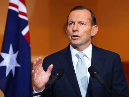CANBERRA, AUSTRALIA - JULY 18: Australian Prime Minister Tony Abbott addresses the media during a press conference at Parliament House on July 18, 2014 in Canberra, Australia. 27 Australians were on board the Malaysia Airlines flight MH17 which was reportedly shot down over Eastern Ukraine. Reports that a surface-to-air missile …