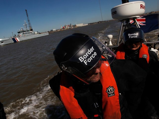 LONDON, ENGLAND - MARCH 16: Border Force officers go out on patrol on a RIB (Rigid Inflatable Boat) which will be operating from the new cutter HMC Protector (pictured behind), on March 16, 2014 in London, England. The cutter, officially launched by the Home Secretary Theresa May MP on 17th …