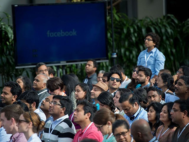 People attend a Townhall meeting with Indian Prime Minister Narendra Modi and Facebook CEO Mark Zuckerberg at Facebook headquarters in Menlo Park, California, on September 27, 2015. AFP PHOTO / SUSANA BATES (Photo credit should read SUSANA BATES/AFP via Getty Images)