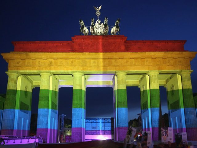 BERLIN, GERMANY - JUNE 18: The Brandenburg Gate is seen with a rainbow flag projected onto it during a vigil for victims of a shooting at a gay nightclub in Orlando, Florida nearly a week earlier, in front of the United States embassy on June 18, 2016 in Berlin, Germany. …