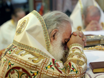 Religious Orthodox Christians leaders pray inside a church in Heraklion on the Greek island of Crete on June 19, 2016. Orthodox churches from around the world meet in Greece on June 19, 2016 for the first such gathering in a millennium, but the absence of several branches of the communion …