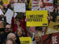 Thousands marched in central London calling on the British government to do more to help refugees fleeing conflict and persecution. / AFP / DANIEL LEAL-OLIVAS (Photo credit should read DANIEL LEAL-OLIVAS/AFP via Getty Images)