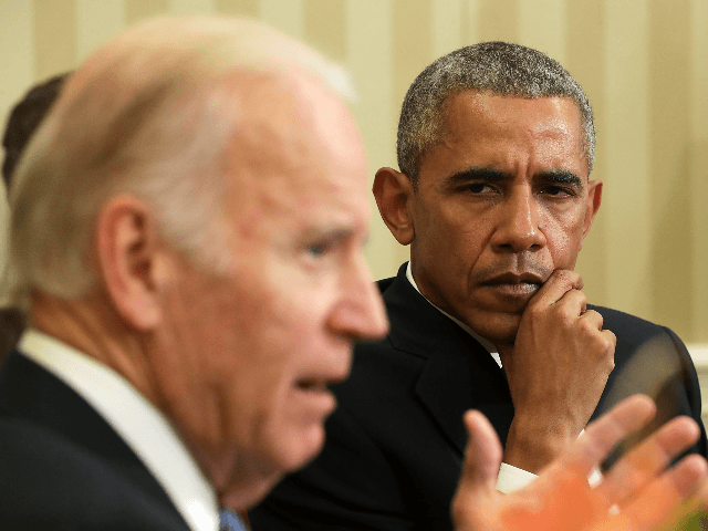 U.S. Vice President Joseph Biden (L) speaks as President Barack Obama (R) listens during a meeting to release the Cancer Moonshot Report in the Oval Office of the White House October 17, 2016 in Washington, DC. Vice President Biden released the report, which focused on speeding up the development of …