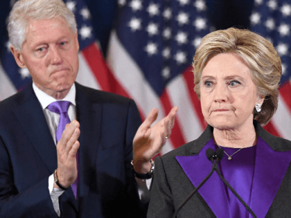 US Democratic presidential candidate Hillary Clinton makes a concession speech after being defeated by Republican President-elect Donald Trump, as former President Bill Clinton looks on in New York on November 9, 2016. / AFP PHOTO / JEWEL SAMAD (Photo credit should read JEWEL SAMAD/AFP via Getty Images)