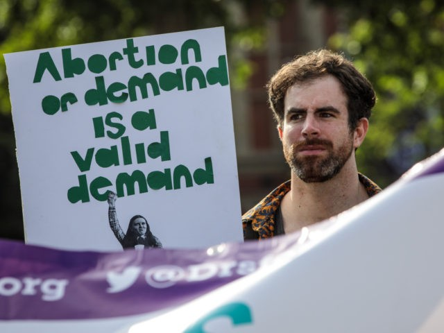 LONDON, ENGLAND - JUNE 05: Pro-choice campaigners hold placards outside the Houses of Parliament during a demonstration to urge the Government to extend the same laws on abortion across the UK, including Northern Ireland on June 5, 2018 in London, England. The British Government in under pressure to liberalise abortion …