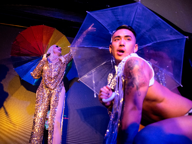 This picture taken on June 9, 2018 shows a drag queen performing onstage at the ShanghaiPRIDE opening party in Shanghai. - Long pressured to deny their identities, Chinese transgenders are quietly asserting themselves, with advocacy groups forming and doctors reporting increasing gender-reassignment surgeries. (Photo by Johannes EISELE / AFP) / …
