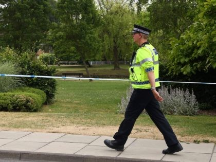 A police officer patrols at a cordon outside Queen Elizabeth Gardens in Salisbury, southern England, on July 4, 2018 believed to be cordoned off in relation to a major incident declared after two people were found unconcious at a residence in nearby Amesbury. - Two people have been hospitalised in …