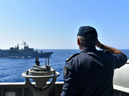 In this photo provided by the Greek Defense Ministry, warships take part in a military exercise in Eastern Mediterranean sea, Tuesday, Aug. 25, 2020. Turkey is accusing France of stoking tensions in the eastern Mediterranean, where NATO allies Turkey and Greece are locked in a stiff standoff over competing claims …