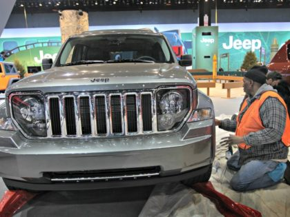 CHICAGO, IL - FEBRUARY 07: Darrell Miller prepares a Jeep Liberty for display at the Chicago Auto Show on February 7, 2012 in Chicago, Illinois. The show, which is the largest and oldest auto show in the country, opens to the public on February 10. (Photo by Scott Olson/Getty Images)