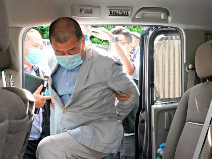 Hong Kong media tycoon Jimmy Lai, who founded local newspaper Apple Daily, gets into a car after being arrested by police officers at his home in Hong Kong, Monday, Aug. 10, 2020. Hong Kong police arrested Lai and raided the publisher's headquarters Monday in the highest-profile use yet of the …