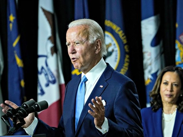 WILMINGTON, DE - AUGUST 12: Democratic presidential candidate former Vice President Joe Biden (L) speaks as his running mate Sen. Kamala Harris (D-CA) looks on during an event at the Alexis Dupont High School on August 12, 2020 in Wilmington, Delaware. Harris is the first Black woman and the first …
