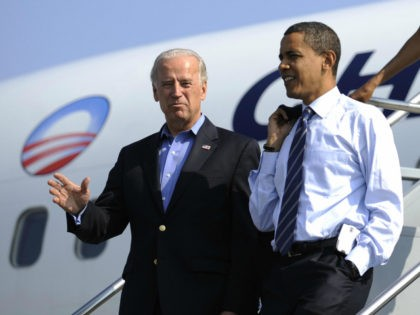 US Democratic presidential candidate Illinois Senator Barack Obama and his running mate Joe Biden disembark from Obama's campaign plane at Detroit Metropolitan International airport in Detroit, Michigan, September 28, 2008. AFP PHOTO/Emmanuel Dunand (Photo credit should read EMMANUEL DUNAND/AFP via Getty Images)