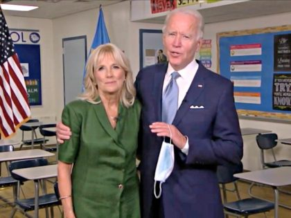 MILWAUKEE, WI - AUGUST 18: In this screenshot from the DNCC's livestream of the 2020 Democratic National Convention, Presumptive Democratic presidential nominee former Vice President Joe Biden holds a mask in his hand as he joins Former U.S. Second Lady Dr. Jill Biden in a classroom after she addressed the …