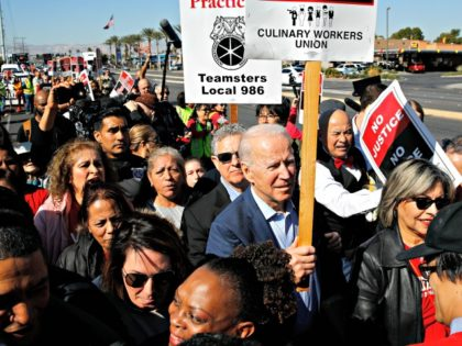 In this Feb. 19, 2020, file photo, Democratic presidential candidate former Vice President Joe Biden walks on a picket line with members of the Culinary Workers Union Local 226 outside the Palms Casino in Las Vegas. Biden's tenure as Barack Obama's vice president is complicating his efforts to deepen ties …