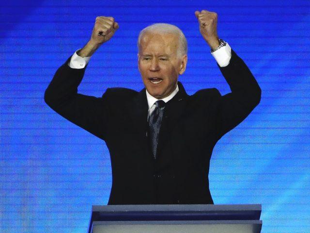 Joe Biden hooray fists (Elise Amendola / Associated Press)