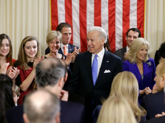 ice President Joe Biden, with his wife Jill Biden, celebrate after taking the oath of office from Supreme Court Justice Sonia Sotomayor surrounded by family during an official ceremony at the Naval Observatory, Sunday, Jan. 20, 2013, in Washington. Family members from left: Noami Biden, Finnegan Biden, Kathleen Biden, Hunter …