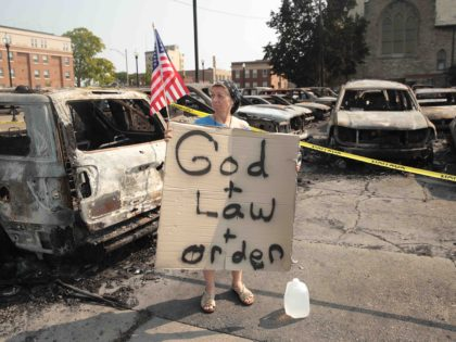 Kenosha riots afterman God and Law and Order (Scott Olson / Getty)