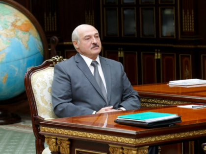 Belarusian President Alexander Lukashenko listens to Valiantsin Sukala, head of the Supreme Court of Belarus during their meeting in Minsk, Belarus, Monday, Aug. 31, 2020. (Nikolai Petrov/BelTA Pool Photo via AP)