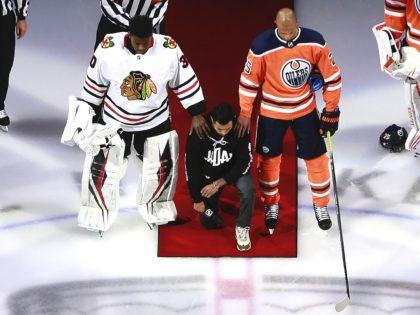Matt Dumba NHL kneel (Jeff Vinnick / Getty)