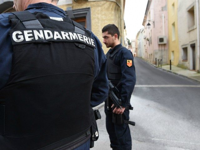 Armed gendarmes stand guard in a street in Marseillan, about 40 kilometres southwest from Montpellier, southern France, on February 10, 2017, where suspects believed to be involved in plotting an attack were arrested by French anti-terrorist police (RAID). Four people including a 16-year-old girl were arrested on February 10 by …